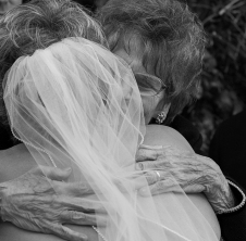 Bride and her mother hugging right after the ceremony. Carol Cizauskas and Gene Cizauskas. The Plumas House, Reno, Nevada. Saturday, 12 October 2013